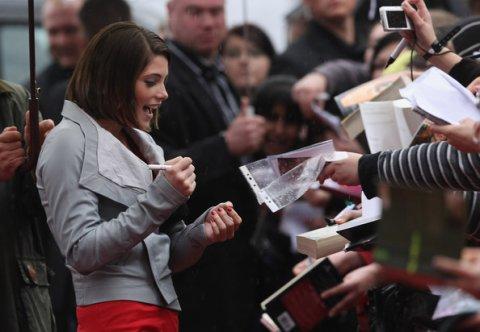 Ashley Greene signing autographs